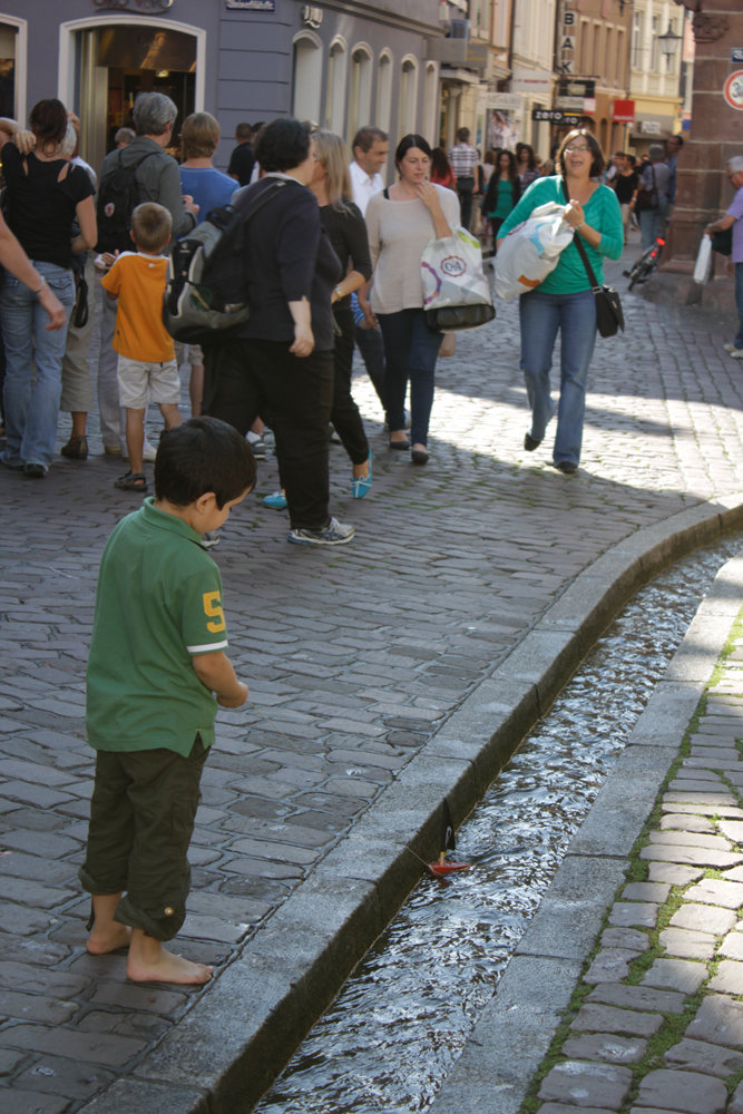 "Another characteristic of the town is the ""Bächle"", which is a unique system of little streams that run through the old part of the town. On hot summer days you can see many people, old and young, cooling off. There is a saying that, if you step in one ""Bächle"", you will marry a person from Freiburg."